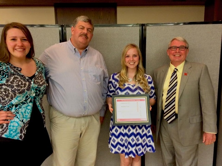 From left: Courtney Anderson, Wildlife Club public relations officer; Larkin Powell, professor; Sara Christianson, Wildlife Club president; and Steven Waller, CASNR dean at the 2015 CASNR Week Banquet. (Courtesy photo)