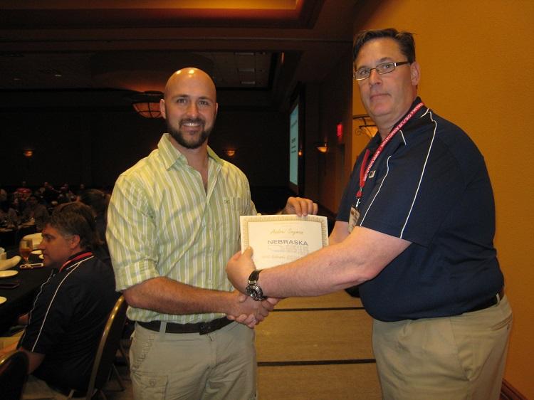 Andrei Snyman, doctoral student, receives the 2015 Nebraska GIS/LIS Association Student Award.