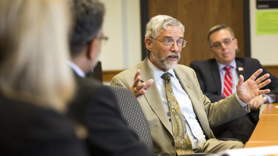 John P. Holdren, the director of the White House Office of Science and Technology Policy and the chief science adviser to President Obama, participates in a May 6 climate roundtable at Hardin Hall. UNL's Ronnie Green is at right.