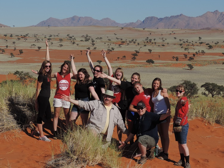 Larkin Powell, professor of conservation biology and animal ecology (center), and students at the NaDEET (Namib Desert Environmental Education Trust) Environmental Education Center in the Namib Desert with the NamibRand Nature Reserve on May 31.