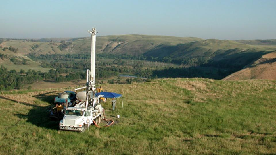 A Conservation and Survey Division crew drills a test well in the Nebraska panhandle. A new guide created by the Conservation and Survey Division is designed to help geologists and drillers catalog material encountered during drilling.