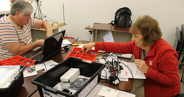 Martha Cook and Norma Thompson (right) build their robots in CSCE 890: Intro to Robotics this summer.
