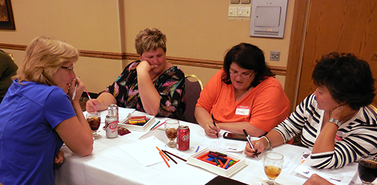 OPS teachers work on a problem at the Math Teachers Circle kickoff in 2014