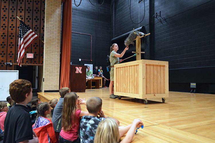 Young NaturePalooza attendees look on as a handler from the Lincoln Children's Zoo feeds a porcupine. (Mekita Rivas   Natural Resources)
