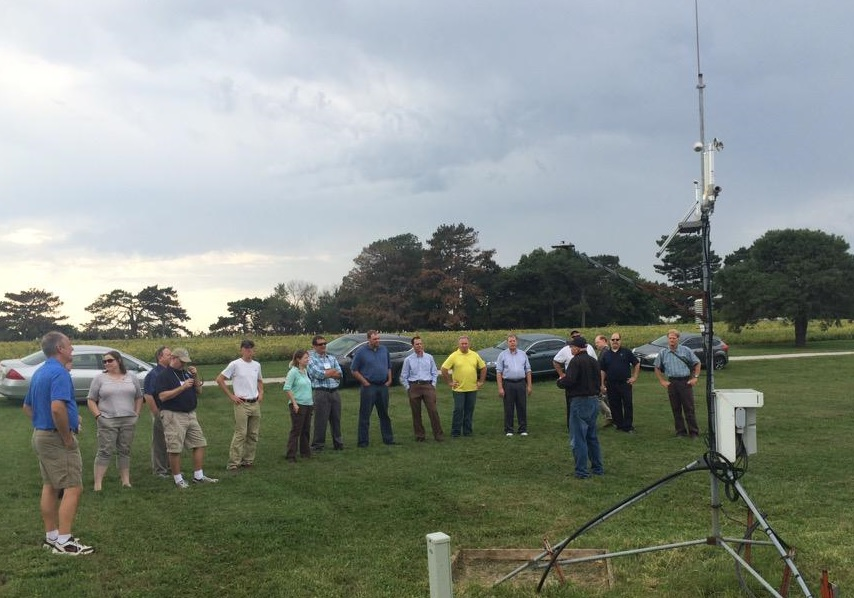Stonie Cooper, HPRCC systems manager, shows participants a station from the Automated Weather Data Network (AWDN) at the pecan orchard on UNL's East Campus. (Photo courtesy Martha Shulski)