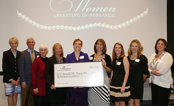The Primarily Math team accepts the award from Women Investing in Nebraska on Oct. 1, 2015.