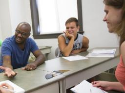 Deadric Williams (second from left), a post-doctoral research associate, leads a discussion with students in his sociology class. A recent poll of rural Nebraskans showed that 65 percent of respondents said a college degree is necessary to get ahead in li