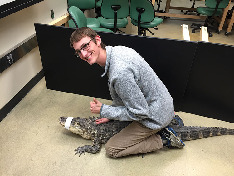 Ethan Freese with an alligator at a Wildlife Club meeting. (Courtesy photo)