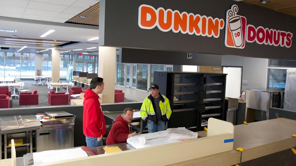 Workers continue the install of equipment in the Dunkin' Donuts café inside the Learning Commons at Love Library on Jan. 5. The Learning Commons and Dunkin' Donuts location are scheduled to open on Jan. 11.