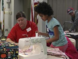 "4-H youth can learn beginning sewing skills at the ""Pillow Party"" workshop."