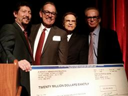 Four members of the Johnny Carson Foundation (left to right) Larry Witzer, Jeff Sotzing, Allan Alexander and Lawrence Heller, present a check for $20 million at the dinner celebrating the announcement of their gift to create the Johnny Carson Center for E