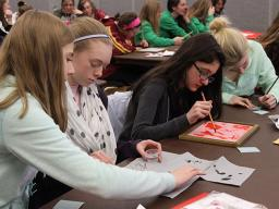 High school students take part in a Harry Potter-inspired chemistry session during the 2015 Women in Science Conference.