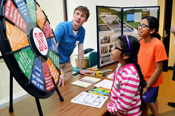 Claudia Carrillo (left) and Paula Carrillo learn about drought from Jake Petr, senior meteorology student at the School of Natural Resources, at the 16th annual Weatherfest and Central Plains Severe Weather Symposium on Saturday, April 16, 2016, at Hardin
