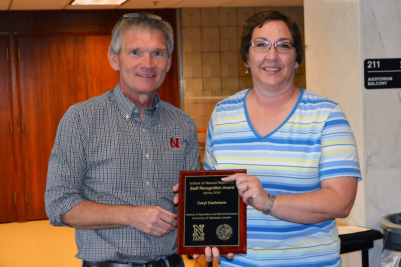 SNR director John Carroll presents Caryl Cashmere with the spring 2016 SNR Staff Recognition Award on April 15. (Shawna Richter-Ryerson | Natural Resources)