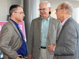NDMC director Mike Hayes (left) and NDMC founder Don Wilhite (right) talk with Sen. Ken Haar during the center's 20th anniversary celebration on Friday at the International Quilt Study Center and Museum.