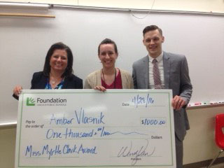Amber Vlasnik (center) receives her award at Lincoln High from the LPS Foundation.