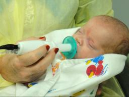 An infant uses the NTrainer System, a therapy device developed by Steven Barlow to stimulate early development of essential feeding skills in preterm infants.