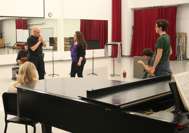 "William Shomos works with students at a rehearsal for ""Amahl and the Night Visitors."""
