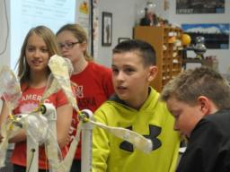 Beatrice Middle School sixth graders watch their handmade wind turbine models in action as a fan flows air at them. (Annie Bohling, Beatrice Daily Sun staff)