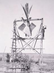 E.H. Barbour, Nebraska State Geologist, uses an anemometer to measure the windspeed and power generated by this windmill in 1898 in Nebraska. This photo and about 40 others are on display at Love Library South, 1248 R St., Lincoln, as part of the exhibit