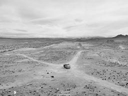 "Lawrence D. McFarland, ""David's Van, Kodak Checking Out Garbage, Mojave Desert, California, 1982,"" limited edition giclée print, 24"" x 36"", 1982 (printed 2010)."