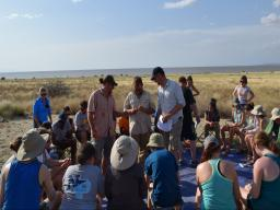 Douglass (center), Jon Reeves (right) and David Braun (back) (George Washington), and Russell Cutts (left) (Univ. of Georgia) instruct students from US and African Universities in stone artifact identification at the Koobi Fora Base Camp on the east shore