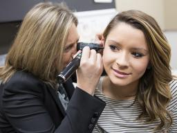 Stacie Ray examines Hannah Lionberger during a hearing screening Jan. 11, 2016.