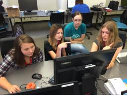 Girl Scouts build an app together at the CSE computer camp.