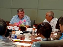 SNR's Larkin Powell, back left, signs the agreement this summer linking UNL to King Mongkut's University of Technology Thonburi in Bangkok, Thailand. At the back right (end of table with Powell) is KMUTT's president Sakarindr Bhumiratana.