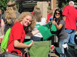 "Courtesy photo | A volunteer from the ""Go Green for Big Red"" initiative hands out recycling bags during a Husker home football game. Volunteers are being sought for the 2016 season."