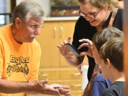 Entomology Professor Fred Baxendale introduces Vinnie the vinegaroon to a BugFest guest in 2015. | Tom Weissling, Department of Entomology