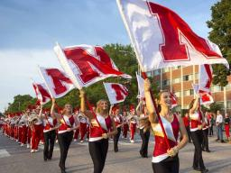 The Cornhusker Marching Band marches down 16th street during the 2015 Homecoming parade. The 2016 parade is 6 p.m. Sept. 30. | University Communications