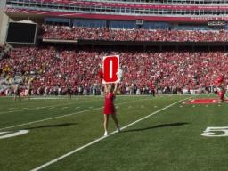 Nebraska cheerleaders take the field for a Husker Power cheer prior to the 2015 homecoming game in Memorial Stadium. Homecoming week activities this year culminate in the Huskers' game with IIllinois on Oct. 1. |  Craig Chandler, University Communication