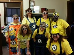 Jill Schurr (back row, second from left) joined the entire Filley Chase Hall Business Center staff in dressing as a Minion last Halloween.