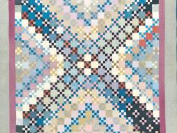 """Nine Patch, made by Barbara Yoder in Weatherford, Oklahoma, circa 1920, is one of the quilts on display in """"Amish Quilts and the Crafting of Diverse Traditions"""" at the International Quilt Study Center & Museum."""