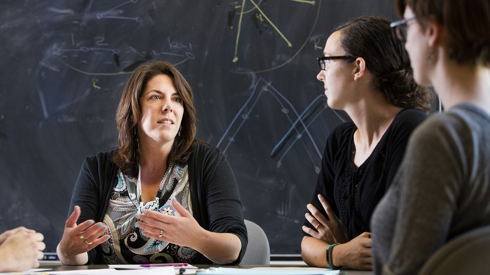 Judy Walker (left) discusses a math question with doctoral students Erica Miller (center) and Allison Beemer. Walker leads a new National Science Foundation-funded project to increase the number of women in mathematics, especially at the doctoral level.
