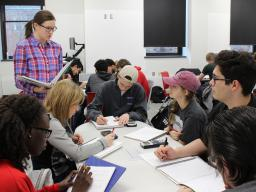 Undergraduate learning assistant Meredith Hovis (left), a secondary mathematics (6-12) major, facilitates group discussions with students in a Math 101 course.