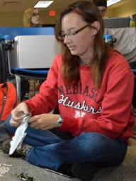 Delanie Bruce, senior fisheries and wildlife major, prepares fish flash cards for the Backpacks for Adventure program.   Shawna Richter-Ryerson, Natural Resources