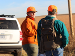 University of Nebraska graduate student Lyndsie Wszola talks to a pheasant hunter about why tracking hunter movements is important to pheasant management. │ Caitlyn Gillespie, formerly with the School of Natural Resources