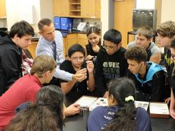 MAst graduate Tony DeGrand (back row, second from left) shows rocks and minerals to his students at Lincoln North Star High School.