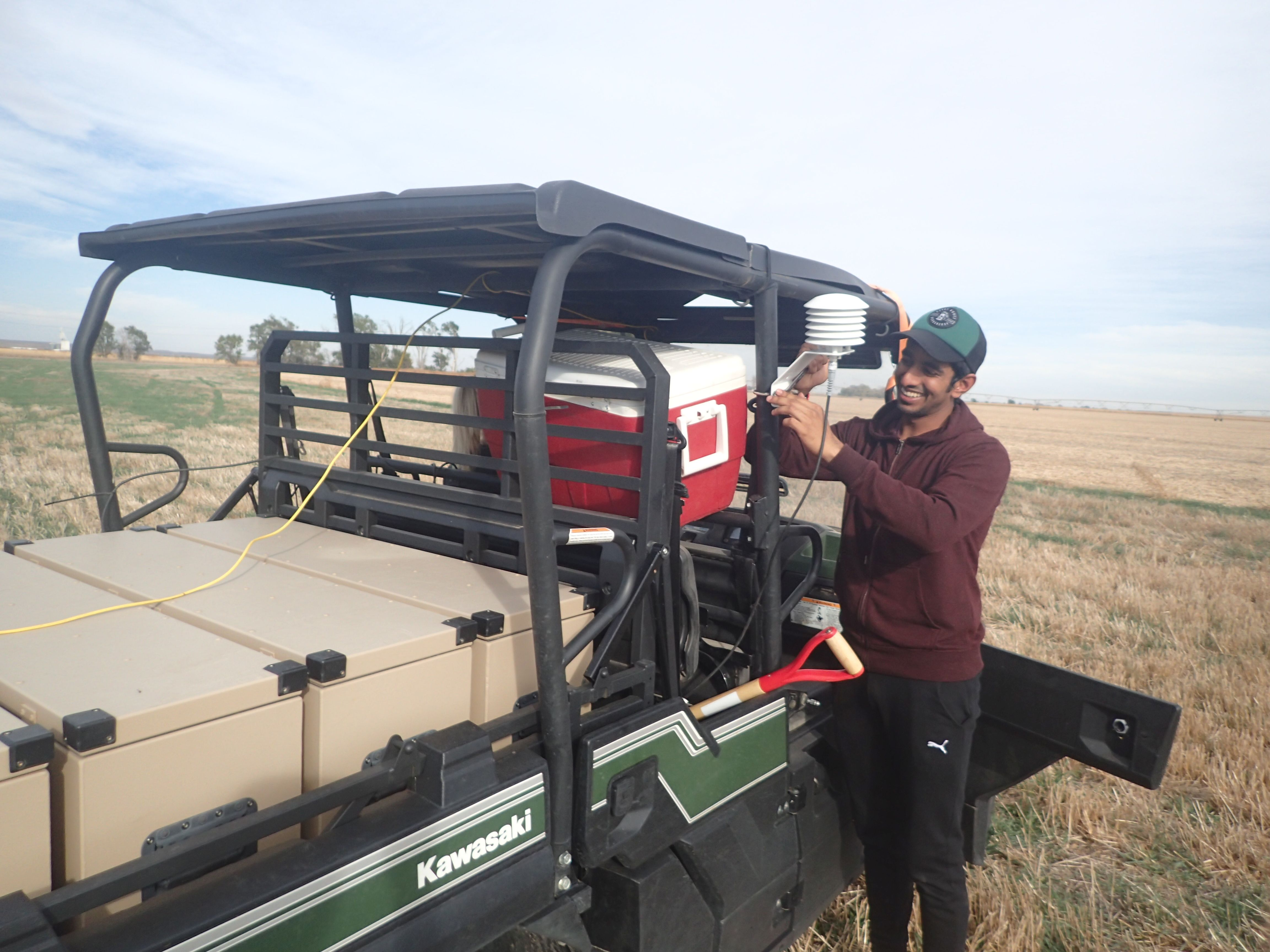 Visiting doctoral student Thigesh Vather works with the cosmic ray rover in western Nebraska, an ATV outfitted with probes that collect soil moisture data from the atmosphere. Vather and WFI Faculty Fellow Trenton Franz analyzed the probe's soil moisture