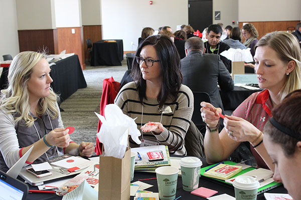 Kristen Slechta of ESU 9 (center) discusses the fortune-telling fish activity with other Summit attendees on Dec. 12, 2016. LINDSAY AUGUSTYN/UNL CSMCE