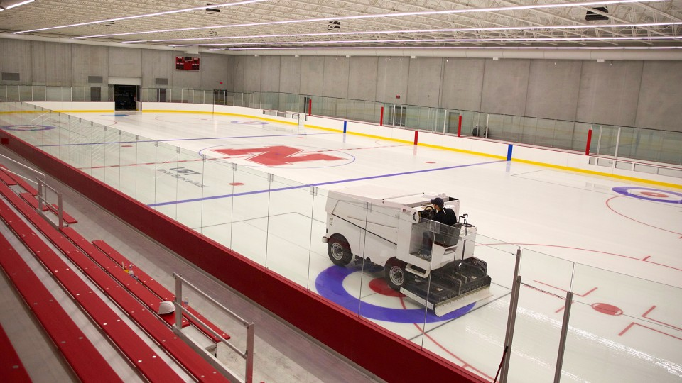 Chris Margiotta, general manager, drives a Zamboni across the rink in the John Breslow Ice Hockey Center. The facility, which is the university's first indoor sheet of ice, opened Dec. 15, 2015. | Troy Fedderson | University Communications