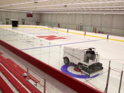 Chris Margiotta, general manager, drives a Zamboni across the rink in the John Breslow Ice Hockey Center. The facility, which is the university's first indoor sheet of ice, opened Dec. 15, 2015.   Troy Fedderson   University Communications