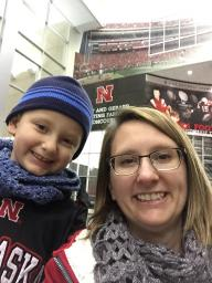 Lindsay and her youngest son, Will, at a Husker football game.
