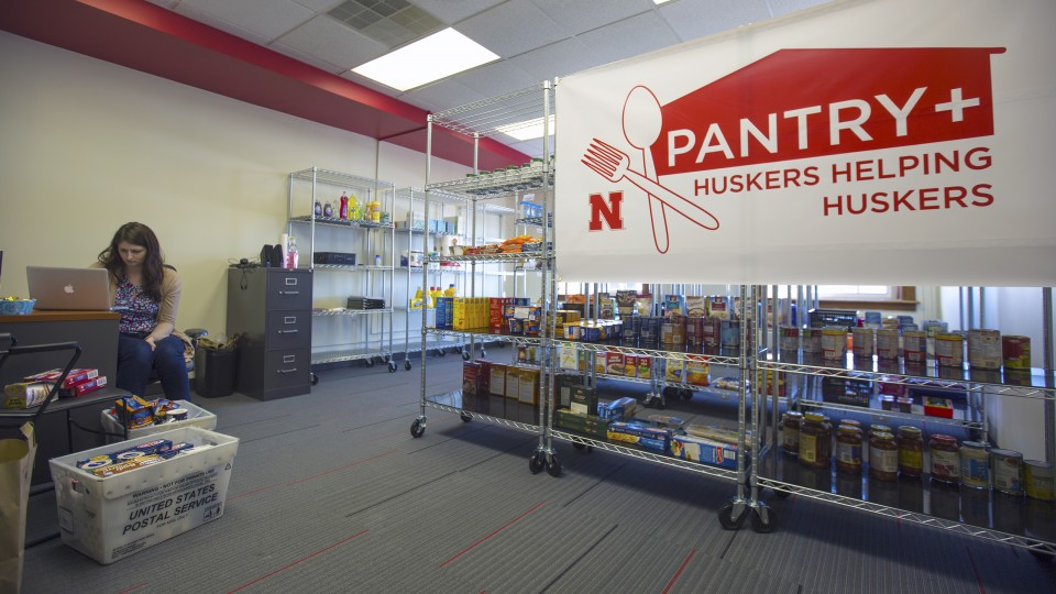 Jessica Lanctot, a graduate assistant, prepares items in the Huskers Helping Huskers Pantry+ on Jan. 6. The pantry, which will offer food, other necessities, housing assistance and financial counseling to students, opens Jan. 9 in the Nebraska Union. |  T