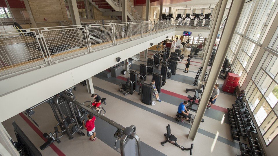 Members of the campus community work out in the Recreation and Wellness Center on East Campus. The facility is home to the university's wellness initiative. | Craig Chandler, University Communication