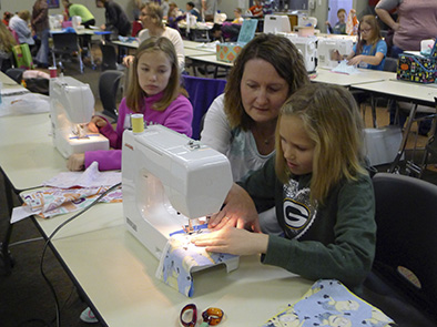 "Many youth learned beginning sewing skills at the 2016 4-H ""Pillow Party"" sewing workshop."
