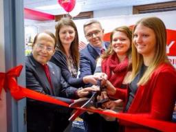 Vice Chancellor Juan Franco and Chancellor Ronnie Green join Pantry+ staff for the grand opening.
