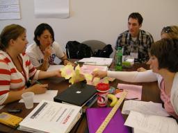 Tom Clark (back, right) helps teachers during New Teacher Network in 2011.
